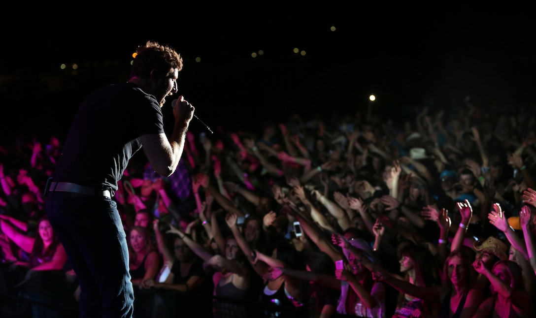 Brett Eldredge, country music star, begins his headlining performance at the We Salute You celebration hosted at Lance Corporal Torrey L. Gray Field, May 17, 2014. The event featured musical performances from Eldredge, Little Texas and the Shuggah Pies.