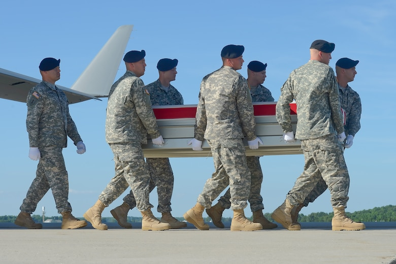 A U.S. Army carry team transfers the remains of Pfc. Jacob H. Wykstra of Thornton, Colo., during a dignified transfer, June 1, 2014, at Dover Air Force Base, Del. Wykstra was assigned to Company A, 1st Battalion, 12th Infantry Regiment, 4th Brigade Combat Team, 4th Infantry Division, Fort Carson, Colo. (U.S. Air Force photo/Greg Davis)