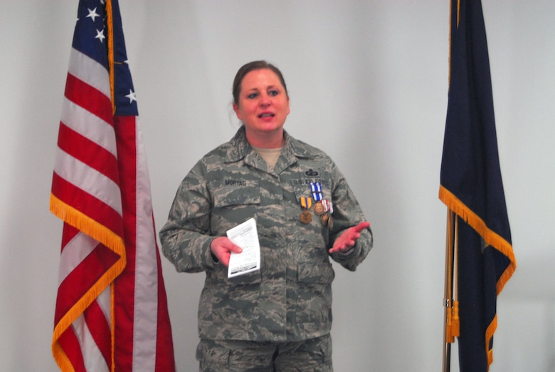 Senior Master Sgt. Ruth Mortag thanks the people who supported her during her deployment at a ceremony to award her numerous medals and accolades at the 120th Fighter Wing April 5. Mortag was deployed to Afghanistan for six months in 2013. (National Guard photo/Staff Sgt. Michael Touchette)