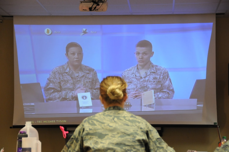 Instructors discuss the subject of military briefings as Senior Airman Ashlee Wajer watches, listens and takes notes. The course allows student to use various learning styles to retain the information presented. (National Guard photo/Staff Sgt. Michael Touchette)