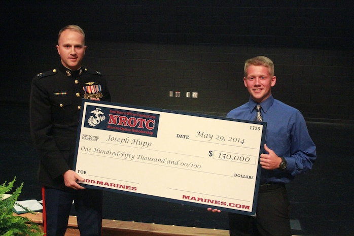 Joseph Hupp, an Ashland, Ky. native and Boyd County High School senior, poses for a photo with U.S. Marine Corps Capt. Eric Albright, the Recruiting Station Charleston Executive Officer, during the high school's awards night May 29, 2014. During the ceremony, Hupp was presented a $150,000 Naval Reserve Officers Training Corps Marine Option Scholarship. The scholarship will cover the cost of tuition and will pay for some of his books, as well as providing a small living stipend. (U.S. Marine Corps photo by Sgt. Tyler Hlavac/Released)