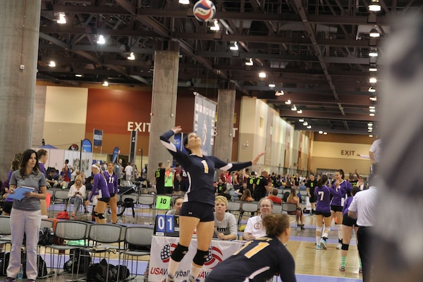 Navy's LT Christine Rostowfske prepares for the spike during the 2014 Armed Forces Championship in conjunction with the 2014 USA Volleyball National Championship in Phoenix, AZ