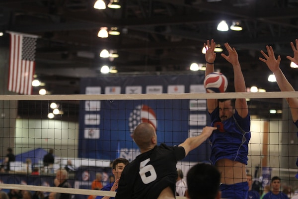 USAF A1C Michael Sofley (Beale AFB, CA) blocks a huge spike from Clay Dooley (Camp Pendleton, CA)