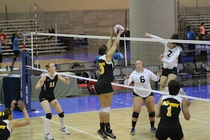 PFC Jessica Glover-#13 (Walter Reed, MD) stuffs the spike during Army's championship run during the 2014 USA Volleyball National Championships 26-28 May