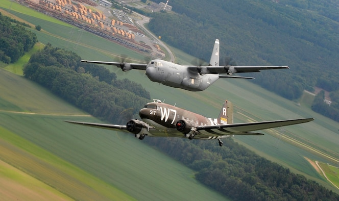 A Douglas C-47 Skytrain, known as Whiskey 7, flies alongside a C-130J Super Hercules from the 37th Airlift Squadron May 30, 2014, over Germany. The C-47 came to Ramstein Air Base, Germany, for a week to participate in base activities with its legacy unit, the 37th Airlift Squadron, before returning to Normandy to recreate its role and drop paratroopers over the original drop zone in Sainte-Mere Eglise, France. (U.S. Air Force photo/Staff Sgt. Sara Keller)