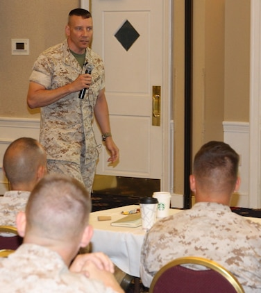 Col. Mike Manning, program manager of Infantry Weapons Systems at Marine Corps Systems Command, Quantico, Virginia, speaks May 13 at the Acquisition Professional Officer Operational Advisory Group. He never thought he would return to acquisition, yet today he is a senior leader at the command.
