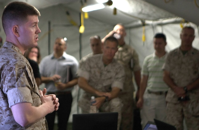 Maj. Troy Peterson briefs visitors May 14 in the Energy Efficient Command Post at Camp Pendleton, California. He is one of the newest Marine Corps ground acquisition professional officers and is assigned to Marine Corps Systems Command, Quantico, Virginia.