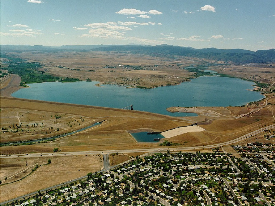 Chatfield Lake lies on the South Platte River at its confluence with Plum Creek, near the foothills of the Rocky Mountains about 25 miles southwest of downtown Denver. The lake is 2 miles long and has an average depth of 47 feet. The lake drains an area of approximately 3,018 square miles. The 1,479-surface-acre lake has a storage capacity of 27,046 acre-feet.