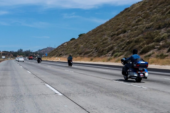 Lieutenant Gen. John A. Toolan, right, commanding general, I Marine Expeditionary Force, rides his motorcycle along Interstate 15 toward Murrieta Calif., May 29, 2014. Nearly 20 Marines participated in the company-sponsored motorcycle ride in an effort to build camaraderie and promote safe motorcycle riding techniques.