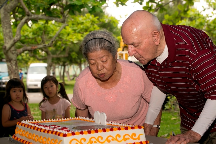 Retired Gunnery Sgt. Samuel C. Bowser, right, and his wife, Yoshiko, blow out birthday candles at a picnic celebrating his 90th birthday May 25 at Comprehensive Park. The couple celebrated their 50th wedding anniversary. Bowser, a native of Duncansville, Pa., served in World War II, the Korean War and the Vietnam War during his 26-year military career. He was a logistics noncommissioned officer and left the Marine Corps with an honorable discharge after the Vietnam War.
