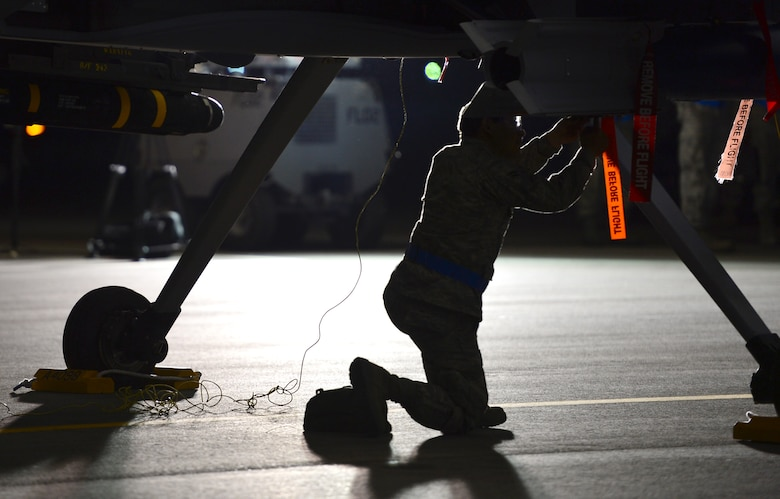 An Airmen assigned to the 432nd Maintenance Group, performs maintenance on an MQ-9 Reaper prior to a launch at Creech Air Force Base, Nev., May 12, 2014. The 432nd Maintenance Group has continuously exceeded the RPA standard mission capable rate of 86 percent set by Air Combat Command through sound maintenance practices. Mission capable means the aircraft has no supply or maintenance issues preventing it from successfully completing a mission. (U.S Air Force photo by Staff Sgt. N.B./Released)