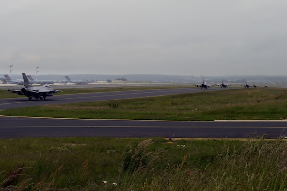 U.S. Air Force F-16 Fighter Falcon fighter aircraft taxi down the runway on Spangdahlem Air Base, Germany, before departing for the U.S. Air Force Aviation Detachment, Poland,  May 30, 2014. This is the fourth fighter aircraft and seventh overall rotation the Av-Det has hosted. (U.S. Air Force photo by Senior Airman Alexis Siekert/Released)