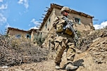 U.S. Army 1st Lt. Ryan Gibbons steps down a hillside while on patrol during Operation Marble Lion in Afghanistan's Jani Khel district, April 12, 2012. Gibbons, a platoon leader, is assigned to Company C, 3rd Battalion, 509th Infantry Regiment.