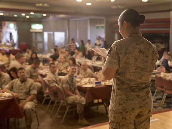 Seaman Colleen Yabut, logistics specialist with Headquarters and Headquarters Squadron, recites a poem in Filipino; her native language. Yabut said being able to recite a poem in her native tongue allowed her to reconnect with her ethnic roots.