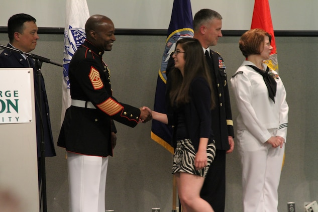 U.S. Marine Corps Sgt. Maj. Mark A. Byrd Sr., a Pontiac, Mich., native and the sergeant major of Marine Corps Base Quantico, shakes hands with future Marine recruit Nina Garrido, an Ashburn, Va. native, recognizing her commitment to enlist directly out of high school at the Our Community Salutes Northern Virginia Chapter recognition ceremony at George Mason University in Fairfax, Va., May 29, 2014. Our Community Salutes Northern Virginia Chapter is an all-volunteer organization that recognizes young men and women who have chosen to join the military immediately following high school graduation. Our Community Salutes started in New Jersey in 2009 and has since spread throughout the country. (U.S. Marine Corps photo by Sgt. Amber Williams/Released)