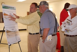 Mike Rogalski, left, speaks to Pahokee and nearby community residents about the proposed Herbert Hoover Dike landside design during a public meeting. At the time, Rogalski served as the Herbert Hoover Dike project manager.