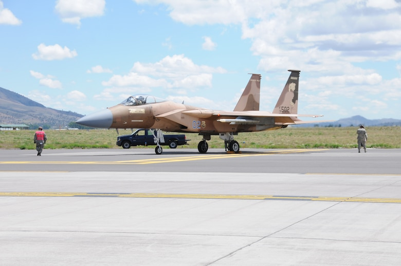 An Oregon Air National Guard F-15 Eagle gets one last look  at the end of runway as it prepares to take off for a training mission at Kingsley Field, Klamath Falls, Ore. May 28, 2014.  The 173rd Fighter Wing is the sole F-15C training base for the United States Air Force and is set to expand its mission this fall with the introduction of Active Duty personnel with a Total Force Initiative.  (U.S. Air National Guard photo by Master Sgt. Jennifer Shirar/Released)