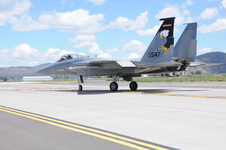 The 173rd Fighter Wing F-15 Eagle Command jet taxis to the runway in preparation for a training mission at Kingsley Field, Klamath Falls, Ore. May 28, 2014.  The 173rd Fighter Wing is the sole F-15C training base for the United States Air Force and is set to expand its mission this fall with the introduction of Active Duty personnel with a Total Force Initiative.  (U.S. Air National Guard photo by Master Sgt. Jennifer Shirar/Released)