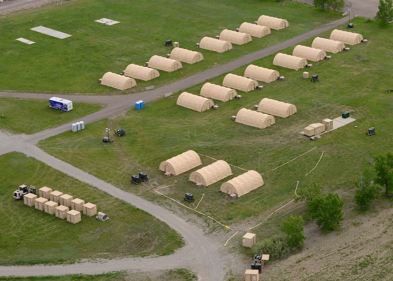 An aerial view shows 21 Disaster Relief Bed-down Systems on the east side of Malmstrom Air Force Base on May 30. The 219th RED HORSE Squadron is one of approximately 10 units in the U.S. with DRBD systems. (U.S. Air Force photo/Senior Airman Katrina Heikkinen)