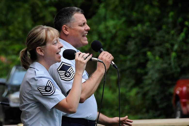 U.S. Air Force Tech. Sgt. Amy Layhew and Master Sgt. Douglas Mattsey, instrumentalists with the Air National Guard Band of the Midwest, perform during the band's annual summer concert series June 30, 2013. Audiences can expect a world-class show with exciting and dynamic music, all while hearing the story of the ANG and the hometown heroes who serve in it, said commander and trumpet player Maj. Bryan Miller. The annual concert series is the result of a year's worth of training and practice, one that the band uses to celebrate patriotism with communities across the Midwest. (U.S. Air National Guard photo by Tech. Sgt. Todd A. Pendleton/Released)