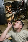 U.S. Air National Guard Airman 1st Class John Williams, 136th Maintenance Squadron, propulsion shop, inspects a C-130 Rolls Royce T-56 turboprop engine at Naval Air Station Fort Worth Joint Reserve Base, Texas, May 18, 2014. Williams prepares to replace a faulty turbine and inspects for other potential problems prior to maintenance. (Air National Guard photo by Master Sgt. Charles Hatton/released)