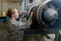 U.S. Air National Guard Staff Sgt. Annette O'Brien,136th Maintenance Squadron, propulsion shop, performs maintenance on a C-130 Rolls Royce T-56 turboprop engine at Naval Air Station Fort Worth Joint Reserve Base, Texas, May 18, 2014. (Air National Guard photo by Master Sgt. Charles Hatton/released)