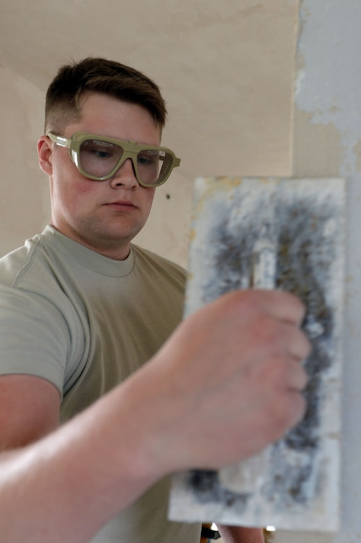 U.S. Air Force Airman 1st Class Lane Kocian, 52nd Civil Engineer Squadron structures journeyman from Luise, Texas, plasters a doorway in an unused building at Spangdahlem Air Base, Germany, June 3, 2014. Structures Airmen have been working this project for almost a month. (U.S. Air Force photo by Senior Airman Alexis Siekert/Released)