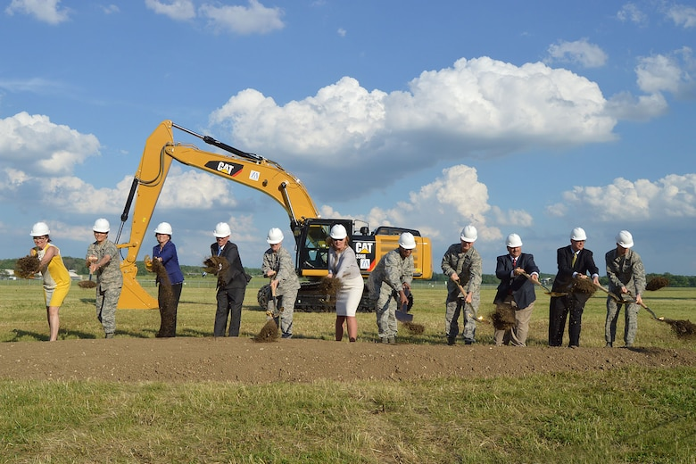 A ceremonial groundbreaking event for the new 224,000 square foot fourth building was held on June 3, 2014, at the National Museum of the U.S. Air Force. (left to right) Amanda Wright Lane, great-grandniece of Orville and Wilbur Wright; Col. Cassie B. Barlow, Commander of 88th Air Base Wing; Fran Duntz, Chairman of the Air Force Museum Foundation Board of Managers; Lt. Gen. (Ret.) Jack Hudson, Director of the National Museum of the U.S. Air Force; Gen. Janet Wolfenbarger, Commander of Air Force Materiel Command; Deborah Lee James, Secretary of the Air Force; Gen. Larry Spencer, Vice Chief of Staff of the Air Force; Lt. Gen. Stephen L. Hoog, Assistant Vice Chief of Staff of the U.S. Air Force; David Dale, Director of Program, U.S. Army Corps of Engineers; Kyle E. Rooney, Vice President and General Manager of Turner Construction Co. (Columbus); and Chief Master Sgt. Michael J. Warner, Command Chief for Air Force Materiel Command. (U.S. Air Force photo/Don Popp)