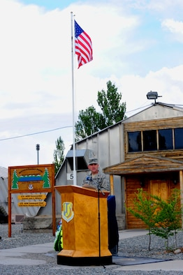 Col. John Millard speaks during the 376th Air Expeditionary Wing's inactivation ceremony June 3, 2014, at Transit Center at Manas, Kyrgyzstan. At the height of operations, approximately 1,500 U.S. military personnel were assigned to the wing, along with approximately 900 U.S. and host-nation contractor personnel who provided daily support to various base missions. Millard is the commander of the 376th AEW. (U.S. Air Force photo/Lt. Col. Max Despain)