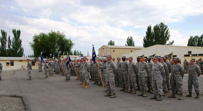 Airmen stand at parade rest during the 376th Air Expeditionary Wing inactivation ceremony June 3, 2014, at Transit Center at Manas, Kyrgyzstan. For more than 12 years, the American military has operated out of Transit Center at Manas. It served as the premier transportation and logistics hub supporting operations in Afghanistan. (Courtesy Photo/Capt. Cory O'Brien)