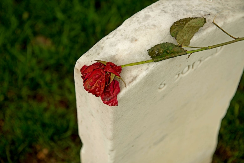A rose lies on top of a tomb stone at the Arlington National Cemetery May 30, 2014. The cemetery commemorates its 150th anniversary June 15, 2014 and has a rich history of honoring those who served.