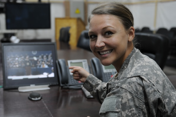 Army Capt. Brooke Jones watches a live stream of the U.S. Air Force Academy Graduation Ceremony May 28, 2014, from a conference room in Kuwait. Her younger brother, 2nd Lt. Blake Jones, graduated that day with the Class of 2014. (Courtesy Photo)