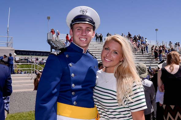 Second Lt. Blake Jones poses with his sister, Navy Ensign Madison Jones, after graduating May 28, 2014 from the U.S. Air Force Academy, Colo. The Jones siblings chose the same path of military service by becoming Air Force, Navy and Army officers. (U.S. Air Force Photo/Liz Copan)