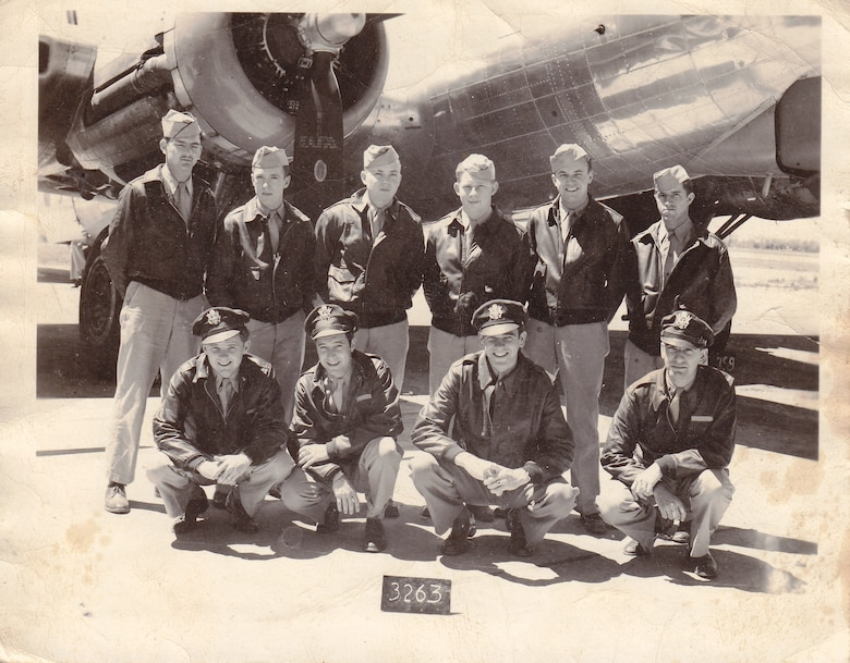 """Rae Carey's initial B-17 Flying Fortress aircrew pose for a photo at Thurleigh Airfield, England in 1944: (front row, left to right) 1st Lt. Dean Allen, pilot; 1st Lt. Charles Rapp Jr., copilot; 2nd Lt. Charles Donahue, navigator; 1st Lt. Michael Vlahos, bombardier; (back row, left to right) Tech. Sgt. Harvey Purkey, engineer and top turret gunner; Tech. Sgt. Robert Newsbigle, radio operator; Staff Sgt. Eugene LeVeque, ball turret gunner; Staff Sgt. Richard Huebotter, waist gunner; Staff Sgt. Charles Reinartsen, waist gunner; and Staff Sgt. James """"Rae"""" Carey, tail gunner. Carey would fly 26 combat missions before being shot down Aug. 26, 1944, during a bombing mission to Gelsenkirchen, Germany. (Courtesy photo/Master Sgt. Matthew Carey)"""