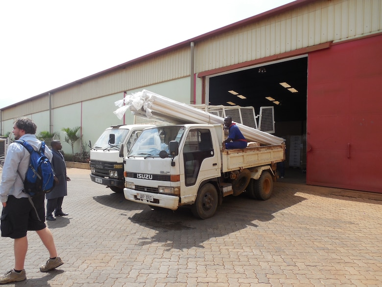 Father Francis, the team's contact in Uganda, found a small truck to retrieve the supplies. With three people in the truck's cab and the bed filled with PVC pipe and gutters for the clinic and school, the team was stopped by traffic police three times while traveling to Gayaza and twice between Gayaza and Makinkee.