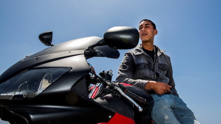 Lance Cpl.  Julio J. Rodriguez, field wireman, 15th Marine Expeditionary Unit, has been riding since he was 17 and plans to continue riding as long as he can aboard Camp Pendleton, Calif. Rodriguez, 22, is from Springfield, Mass. (U.S. Marine Corps photo by Cpl. Emmanuel Ramos/Released)