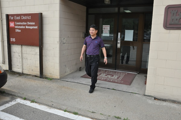 Sung Ho, mechanical engineer in construction division's quality assurance branch, leaves his office at the district's compound in Seoul, Korea.