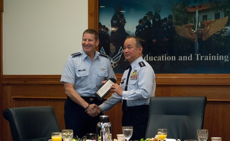 Gen. Robin Rand, commander of Air Education and Training Command, and Lt. Gen. Masayuki Hironaka, commander of the Air Training Command for the Japanese Air Self-Defense Force, Japan, exchanges tokens of appreciation. Hironaka visited units throughout Air Training and Education Command May 12, 2014. (U.S. Air Force photo by Capt. Ashley Walker)