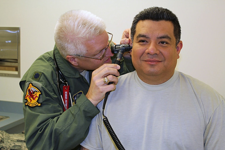 Lt. Col. (Dr.) Brian Schroeder examines Staff Sgt. Ernest Martinez at Selfridge Air National Guard Base, Mich., May 17, 2014. Schroeder is a physician with the 127th Medical Group, which is tasked with ensuring the medical readiness of the Airmen assigned to the 127th Wing, Michigan Air National Guard, at Selfridge. Martinez is a member of the 127th Logistics Readiness Squadron at Selfridge. (U.S. Air National Guard photo by Technical Sgt. Dan Heaton / Released)