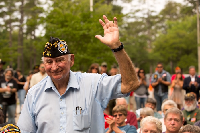 Larry Fitzpatrick, a former Onslow County Commissioner and retired Marine, stands and waves during the Vietnam Veterans Memorial rededication ceremony, at Lejeune Memorial Gardens in Jacksonville, May 31. Fitzpatrick was one of three who initiated the creation of the memorial. The ceremony honored the memory of those who perished during the war and celebrated the accomplishments and perseverance of Vietnam-era veterans.(U.S. Marine Corps photo by Cpl. Jackeline M. Perez Rivera/Released)