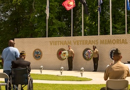 Marines stand alongside wreaths, in memory of Vietnam veterans and the appreciation of a grateful nation, during the Vietnam Veterans Memorial rededication ceremony at Lejeune Memorial Gardens in Jacksonville, N.C., May 31. The ceremony honored those who perished during the war and celebrated the accomplishments and perseverance of Vietnam-era veterans.(U.S. Marine Corps photo by Cpl. Jackeline M. Perez Rivera/Released)