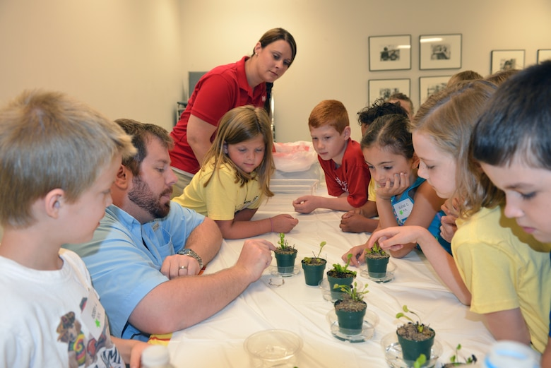 Casey Ehorn, a wetland biologist  with the U.S. Army Corps of Engineers Nashville District Regulatory  Branch, talks to  kids at the Williamson County Junior Gardener Camp at the Agricultural Exposition Park June 3, 2014 as Mary Lewis (left) also a biologist from the planning branch.