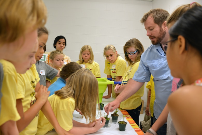 Casey Ehorn, a wetland biologist  with the U.S. Army Corps of Engineers Nashville District Regulatory  Branch, explains the Venus flytrap plant to  kids at the Williamson County Junior Gardener Camp at the Agricultural Exposition Park June 3, 2014.