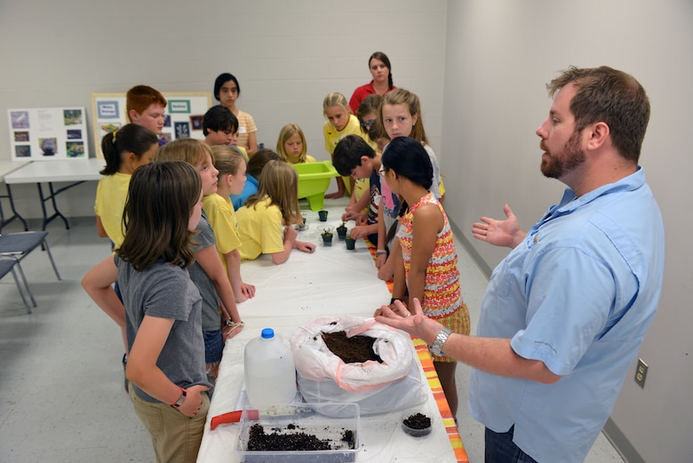 Casey Ehorn, a wetland biologist  with the U.S. Army Corps of Engineers Nashville District Regulatory  Branch, answers questions and explains how the Venus flytrap survives in wetland areas to kids attending  the Williamson County Junior Gardener Camp at the Agricultural Exposition Park June 3, 2014.