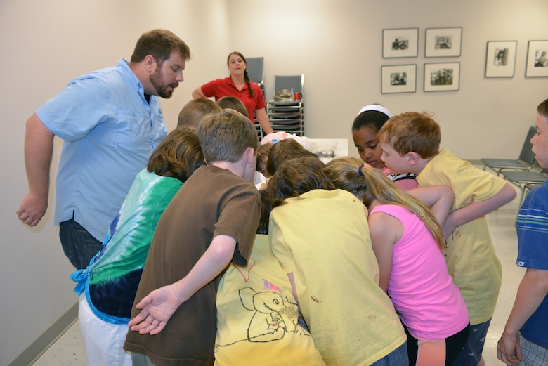 Casey Ehorn, a wetland biologist  with the U.S. Army Corps of Engineers Nashville District Regulatory  Branch, explains soil variations about the Venus flytrap to  kids at the Williamson County Junior Gardener Camp at the Agricultural Exposition Park June 3, 2014.