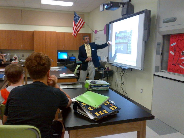 Army Corps Architect Charles Paray showing students the steps he takes to design a project.