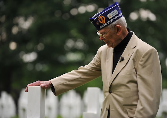 World War II veteran Leslie Cruise pays his respects to the man who saved his life seventy years ago with a wreath laying ceremony June 2, 2014, at Lorraine American National Cemetery and Memorial, St. Avold, France. Seventy years ago on June 7, 1944, Pvt. Richard Vargas saved Cruise's life during the invasion of Normandy. Cruise went to France several times prior to this visit looking for his friend's grave in order to say thank you. (U.S. Air Force photo/Senior Airman Hailey Haux)