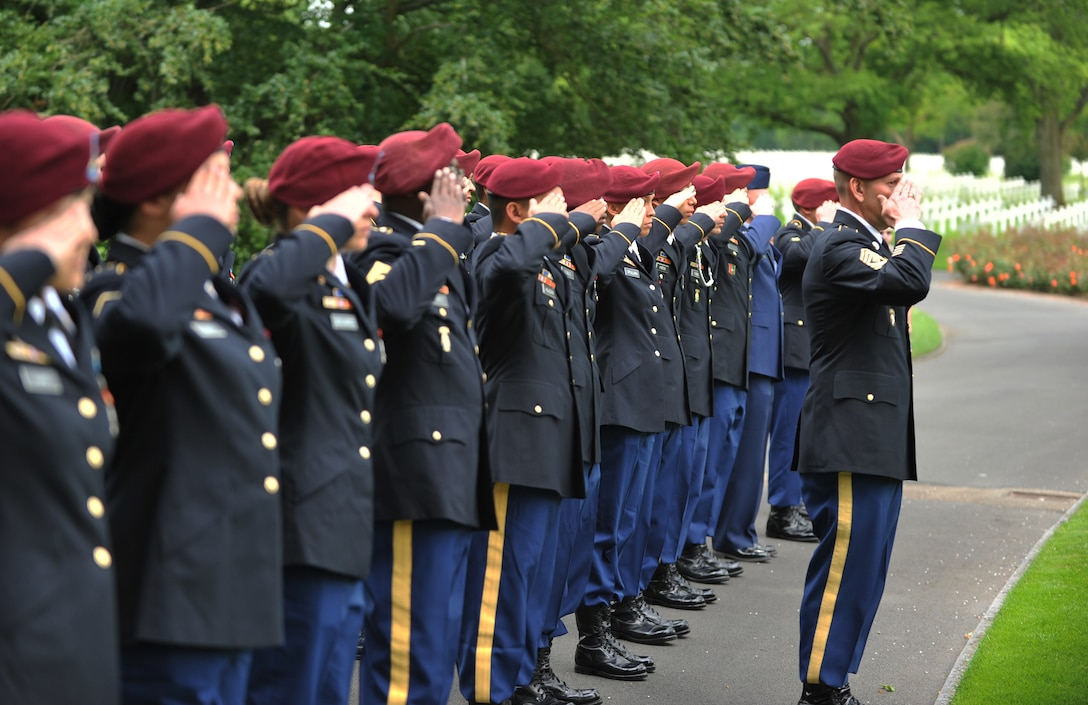 Members of the 5th Quartermaster Theater Aerial Delivery Company and the 435th Air Ground Operations Wing's Contingency Response Group salute the grave of Pvt. Richard Vargas during a wreath laying ceremony June 2, 2014, at Lorraine American National Cemetery and Memorial, St. Avold, France. Seventy years ago on June 7, 1944, Vargas lost his life during the invasion of Normandy. (U.S. Air Force photo/Senior Airman Hailey Haux)