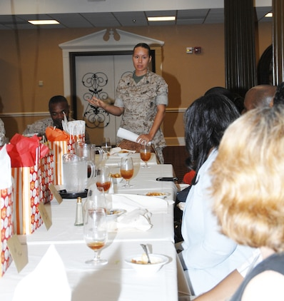 Staff Sgt. Juana Snell, founder of Mentors In Action, expresses her appreciation to Marines for their participation in the M.I.A. program during a luncheon held at the Town and Country Restaurant's Grand Ballroom here, May 28.