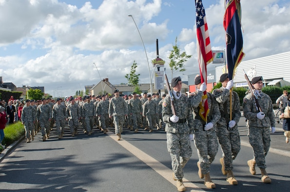 Soldiers from the 101st Airborne Division, along with allied troops from multiple countries, participate in a parade June 4, 2014, through the streets of Carentan, France. The town is hosting several events commemorating the 70th anniversary of D-Day operations conducted during World War II. (U.S. Army photo/Sgt. A.M. LaVey)
